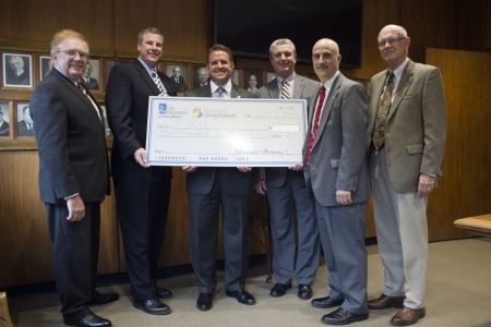 Big check presentation from Erie Insurance to EKU officials
