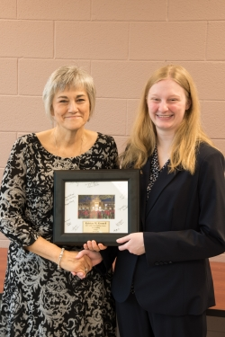 Kristen Gosnell (right) receives award from Dr. Trish Isaacs