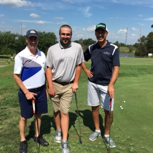 Hole-in-one winner Cody Gilliam (center) with his team